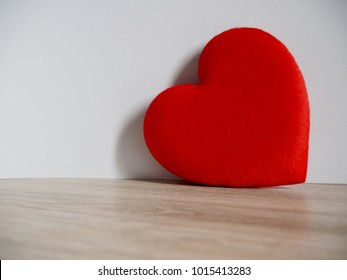 Red Heart on the wood table with white background. Space for write about love Valentines's Day
