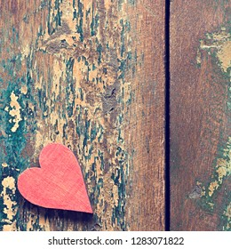 A red heart on a wooden background