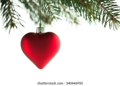 Red heart on the xmas tree on white background isolated. Merry christmas card. Winter holiday theme. Happy New Year.