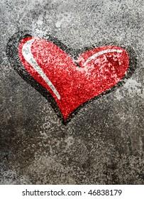 red heart onan old grey wall