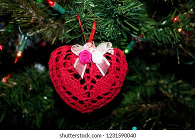 Red Heart Ornament made of Lace Hanging on a Christmas Tree