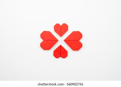 Red heart paper on white background, love and valentine symbol.