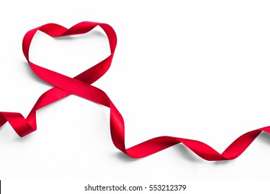 Red heart ribbon isolated on white background (clipping path), symbolic concept for National heart month