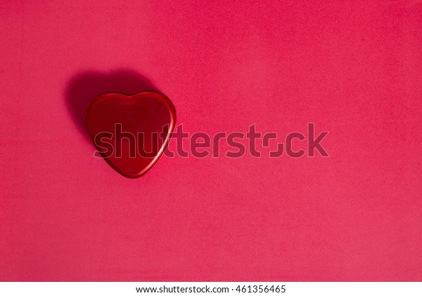 red heart shape on red background