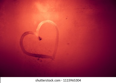 Red heart shape on steamed miror