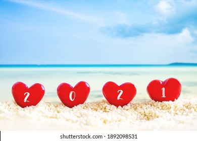 red Heart shape on white sand beach ,Image for love valentine day or summer vacation concept