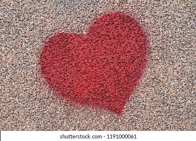 Red heart shape spray paint at wall love