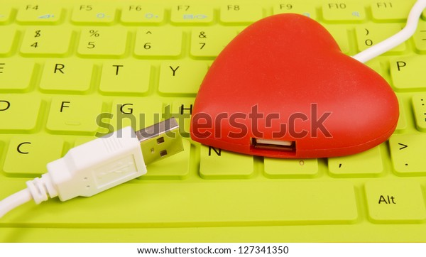 red heart shape of USB hub connect with laptop
