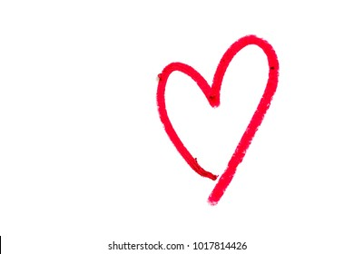 Red heart shape written from red lipstick on white background with copy space for Valentine's day and love concept