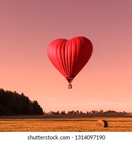 Red heart shaped air ballon, trendy color coral toned landscape