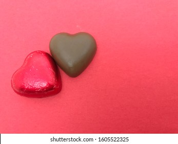 Red heart shaped chocolate candies, top view. Gentle cute gift and dessert treat by February 14, Valentine's Day, a sweet gift for lovers