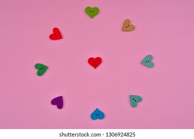 Red heart smile in pink background. Valentine's concetp, flat lay style
