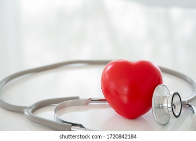 red heart with stethoscope at hospital. cardiovascular and heart health care concept.