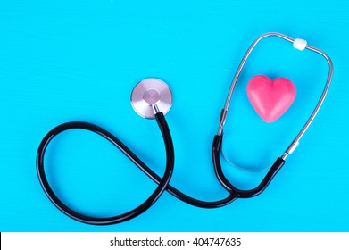 Red heart and a stethoscope on a blue background. Medical concept.