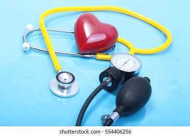 Red heart and a stethoscope on blue background