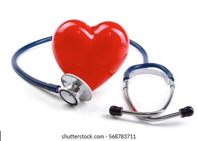Red heart and a stethoscope on desk