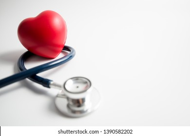 Red heart with stethoscope on white background, heart health, health insurance concept, world health day.