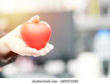 The red heart that the young woman gave, With soft light focus