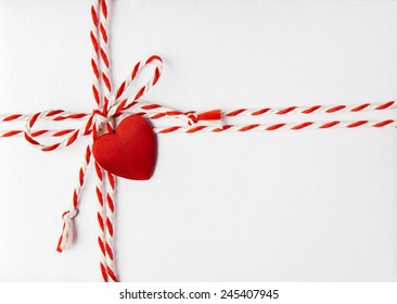 Red Heart Valentine Day Background, Wedding Invitation Card Envelope with Ribbon, Rope Tied Bow Knot. Love Greeting Mail Concept.