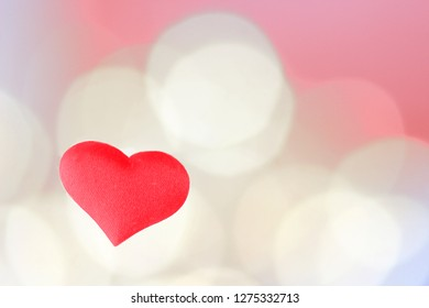 Red heart for Valentines day in front of defocused lights with room for your text or copy