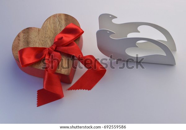 red heart for valentine's day and pigeons  for the wedding on a neutral background