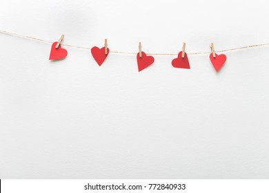 Red hearts hanging on clothesline