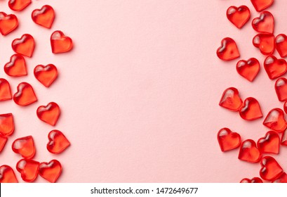 Red hearts on a pink background as  frame. Empty place for copy space for text. mock-up