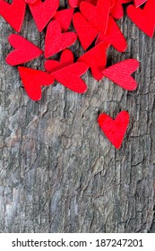 red hearts on rustic wooden surface