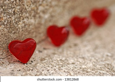 red hearts on stone