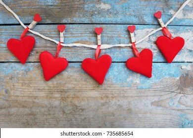 Red hearts on wooden background.Valentines day greeting card.Top view with copy space