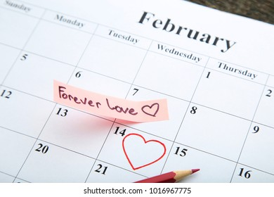 Red hearts painted on february calendar