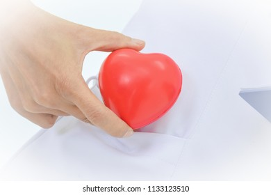 Red hearts put in white shirts with love and care by nurse or doctor.