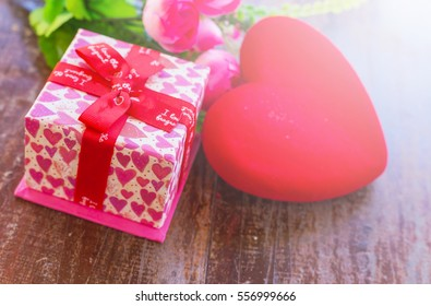 Red Hearts and Surprise gift box On Wooden.