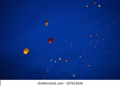 Red heart-shaped chinese lantern in the night sky