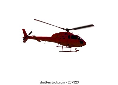 Red helicopter in the air over a PURE WHITE background.