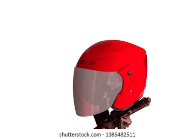 Red helmet hang on the motorcycle handlebars.isolated on white background.