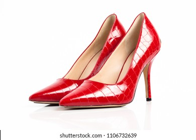 Red high heel shoes isolated on a white background.