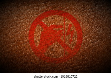 red high voltage warning sign painted on brown leather texture texture background