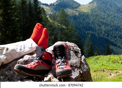 red hiking boots for a hike in the mountains of austria. activity in leisure time