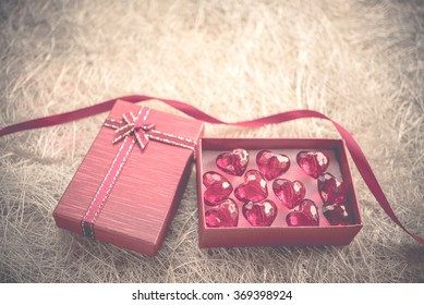 Red holidays gift and heart on wood background/ Valentine's day background ,vintage style