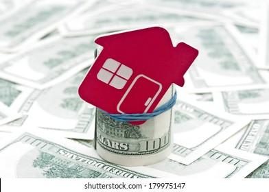 red home sign on hundred dollar bills. Real Estate business Concept