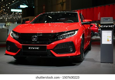 Red Honda Civic in Geneva International Motor Show (GIMS), Geneva Switzerland March 2019. This car offers beautiful new design, a lot of space and joy to dride. Portrait color image.