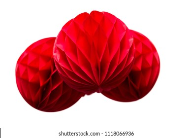 Red honeycomb pom-pom paper balls decoration isolated on white background