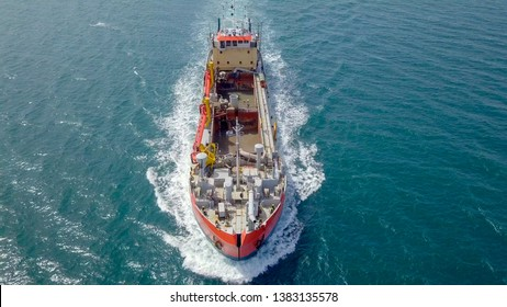 Red Hopper-Dredger ship at sea, Aerial image.