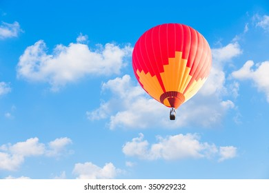 Red hot air balloon on blue sky