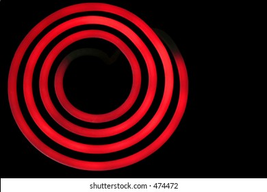 A red hot burner isolated on a black background.