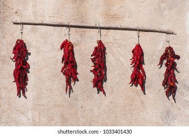 Red hot chili peppers drying on a house of the village of Aieta, Italy. Aieta (also written in Ajeta form) is an Italian municipality of 814 inhabitants in the province of Cosenza in Calabria.