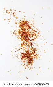 Red hot chili pepper's flakes. White background. isolated