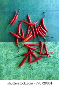 Red hot chili peppers on green background