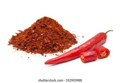 Red hot chilies with powder over white background